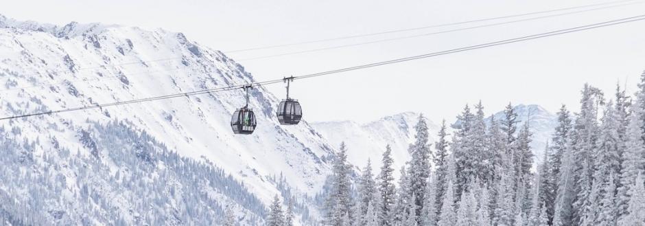 Aspen Snowfall on gondola and mountains