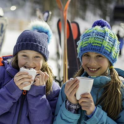 kids drinking hot cocoa in aspen