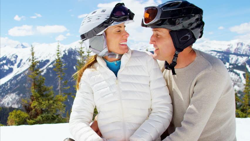 couple skiing in aspen colorado